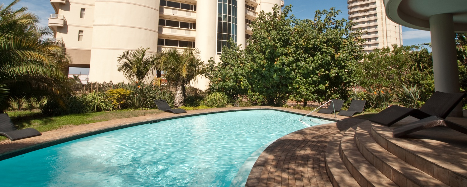 One of two swimming pools at The Oyster Apartments with a splash pool for the kids